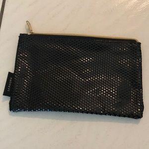 Makeup bag or purse.